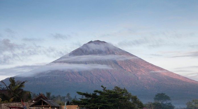 Bali's highest volcano Mt Agung, seen from the black sand beach at Amed village in East Bali, Indonesia.